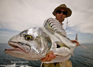 fisherman with roosterfish, pescador con pez gallo